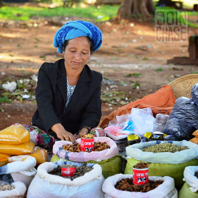 A woman selling her goods at a small, rural market in Shan State, Myanmar.