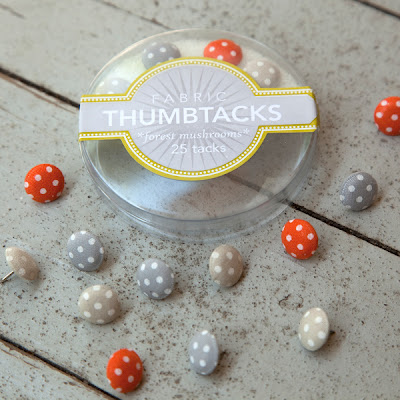 fabric-covered thumbtacks