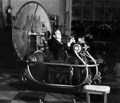 Rod Taylor sitting in a Hercules barber's chair in The Time Machine movie