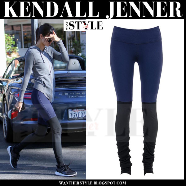 Kendall Jenner in grey top, blue and black alo yoga leggings and black puma arial sneakers what she wore models off duty