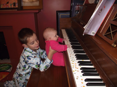 baby learning piano