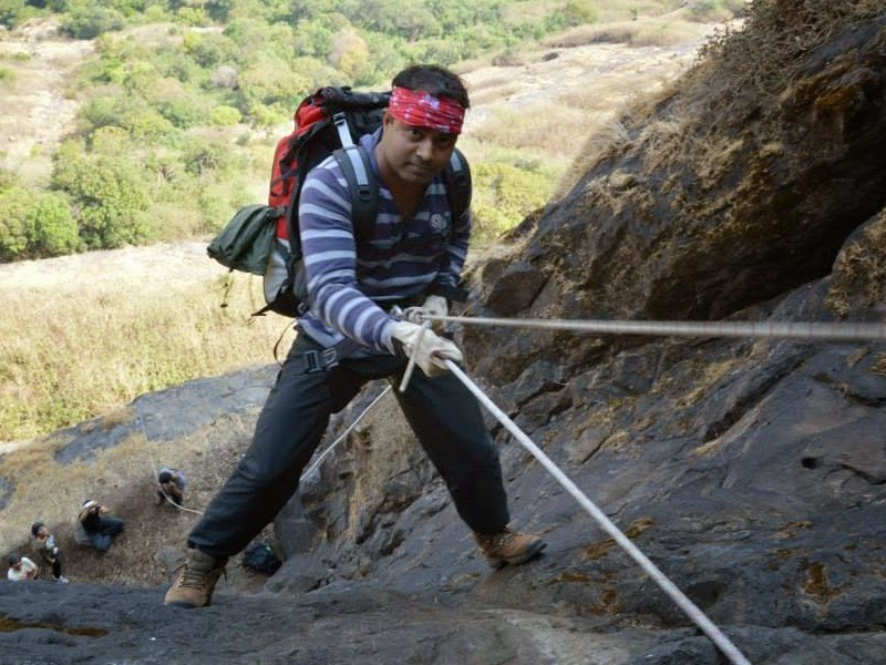 Salil Mahadik rappelling down the 70 feet rock patch on Alang