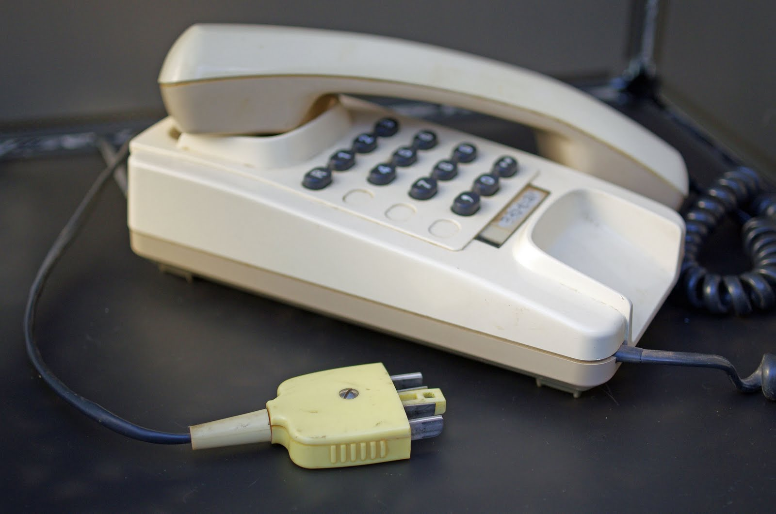 Old fashioned phone plug into cell 94
