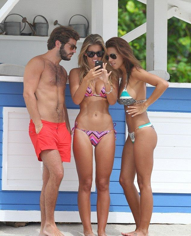 Natasha Oakley apparently has a deal with the photographer camera to capture her while she's at the best whether in an Aztec bikini with boyfriend in Miami, FL, USA on Thursday, July 24, 2014.