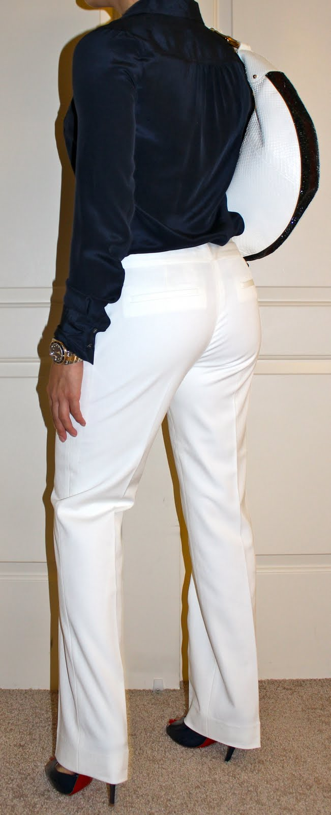 white pants and white Gucci python purse