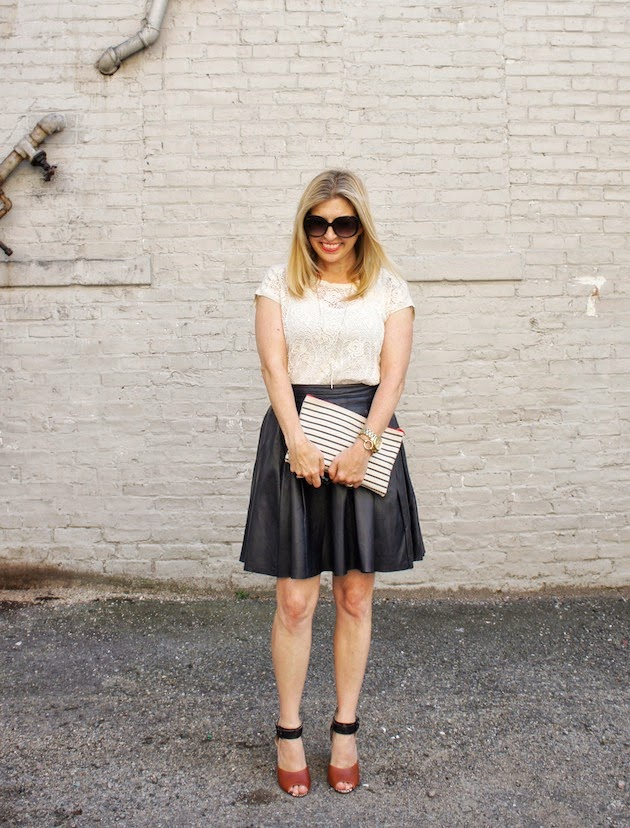 leather skirt, lace tee, stripe clutch