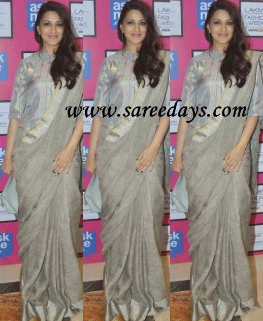 Latest saree designs sonali bendre in beige designer saree checkout sonali bendre in beige designer saree with border and paired with matching half sleeves blouse altavistaventures Image collections