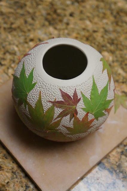 Beautiful unique leaf imprint ceramic pottery hand thrown vessel - in progress.