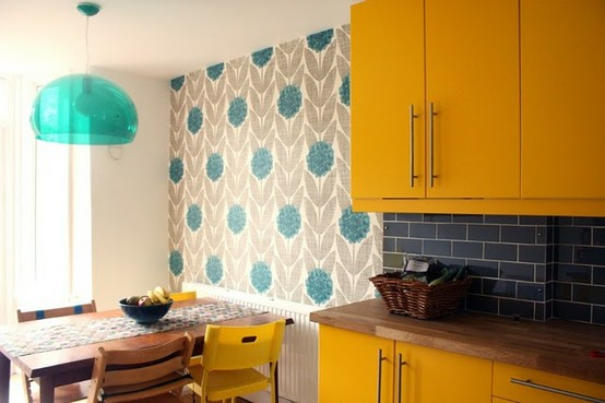 cabinets mixed with the vintage wallpaper print in this kitchen