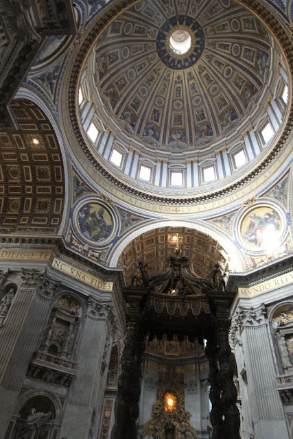 Michelangelo's dome high above the baldacchino in St Peter Basilica in Vatican City, Rome, Italy