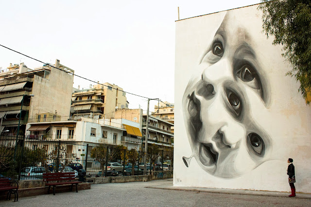 """""""New Future"""" Mural By Greek Street Artist iNO on the streets of Athens in Greece."""