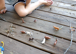 Tessa put her critters to work. The moose has the biggest antlers, so he gets the biggest stick.