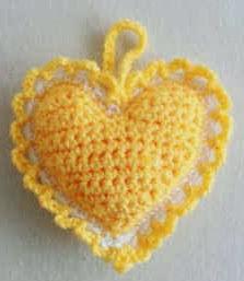 http://www.bestfreecrochet.com/2012/03/14/free-crochet-pattern-heart-sachet-74/