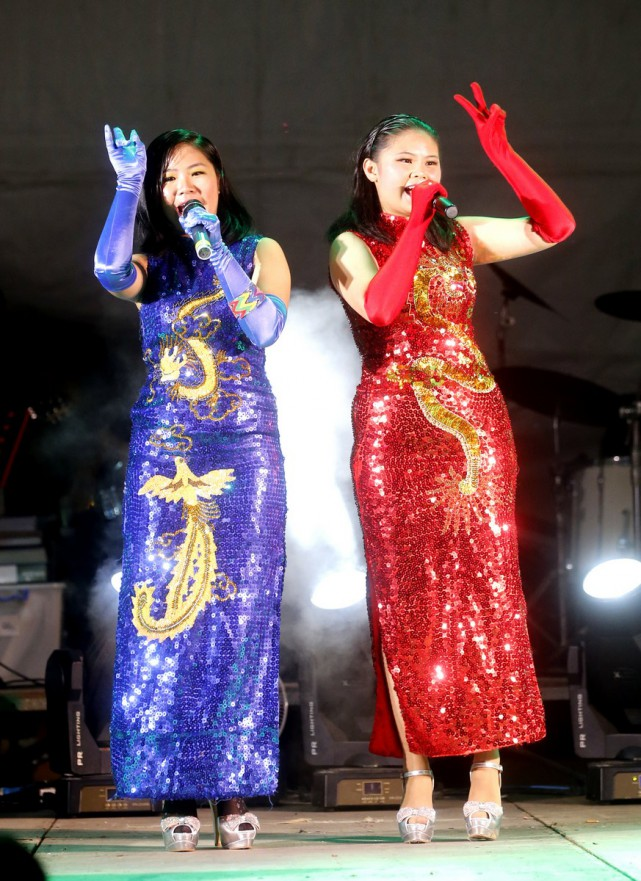 Singaporean sisters Susan (right) and Regina Yeo (left) take on the competition by playing musical instruments during their shows.