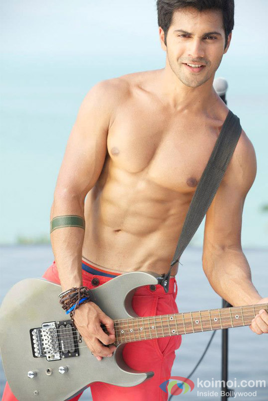 Dhawan-poses-with-a-guitar-in-student-of-the-year-movie-stills