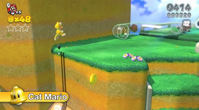 Mario in his new cat suit, climbing a wall to reach a flat area with a clear pipe in the background. A few goombas can be seen in the distance. Screenshot from the Wii U game Super Mario 3D World.