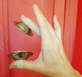 wearing finger cymbals