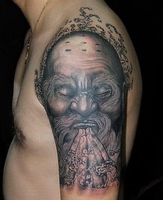 monk portrait tattoo on the arm