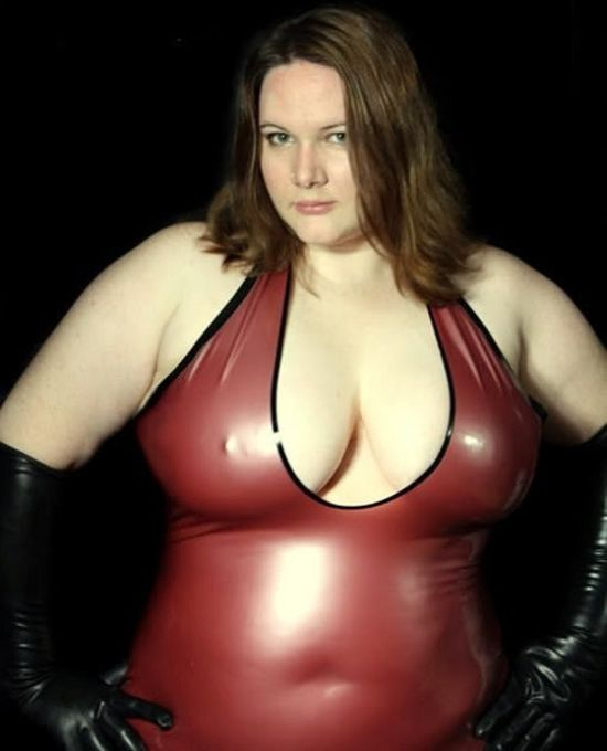 woman wearing a red latex top and black gloves, curves