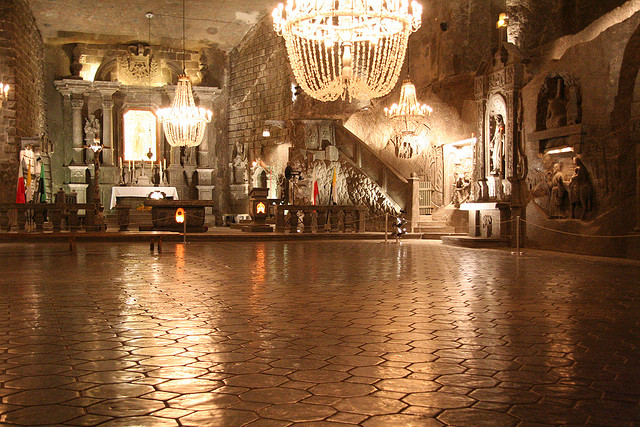 The Polish town of Wieliczka has a subterranean salt mine that houses a cathedral complete with chandeliers made of salt. Photo from Flickr