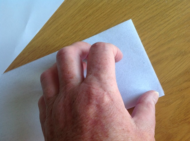 picture of a hand folding the interfacing