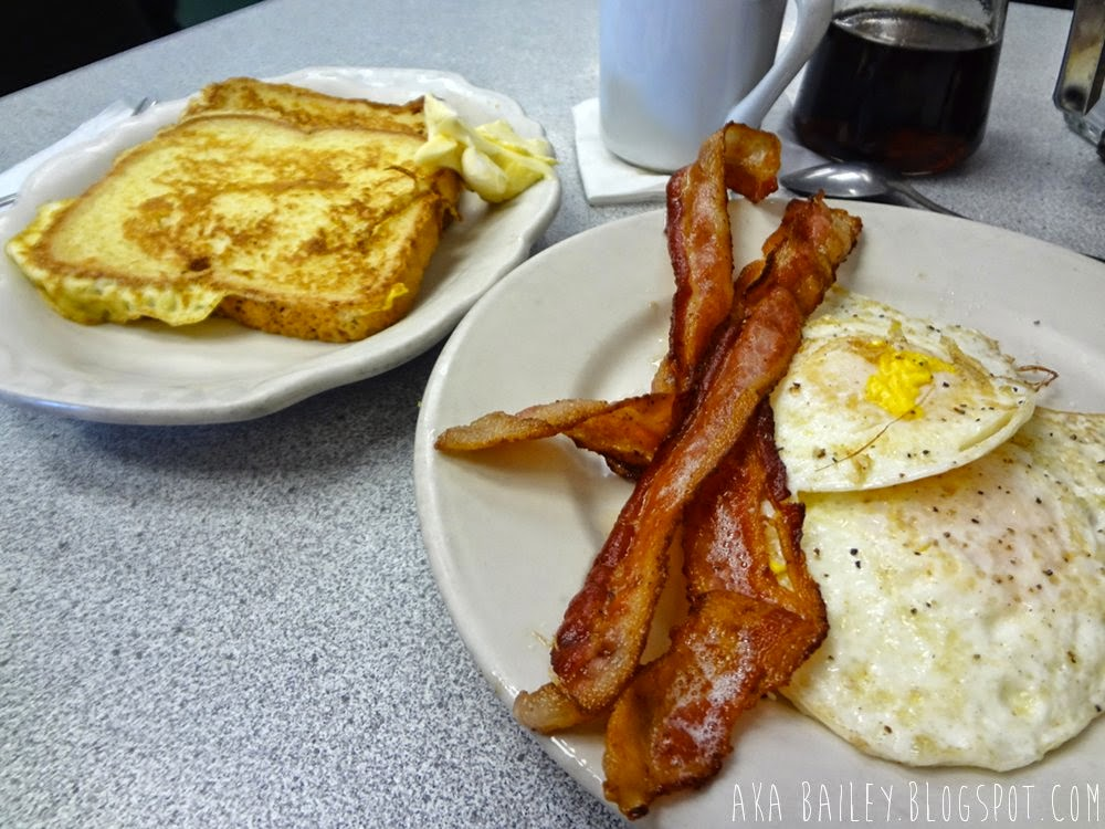 French toast, bacon, eggs, and coffee, breakfast from Donut Villa