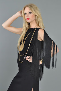 Vintage 1970's black knit mini fringe dress.