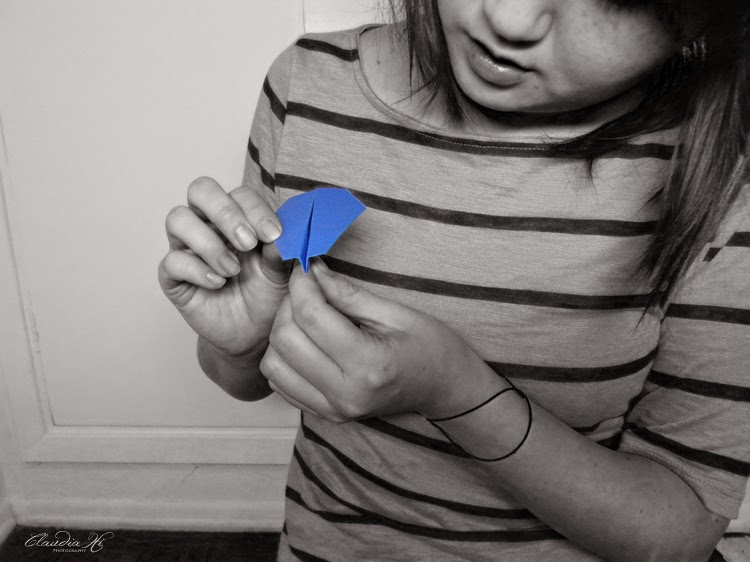 blue paper airplane