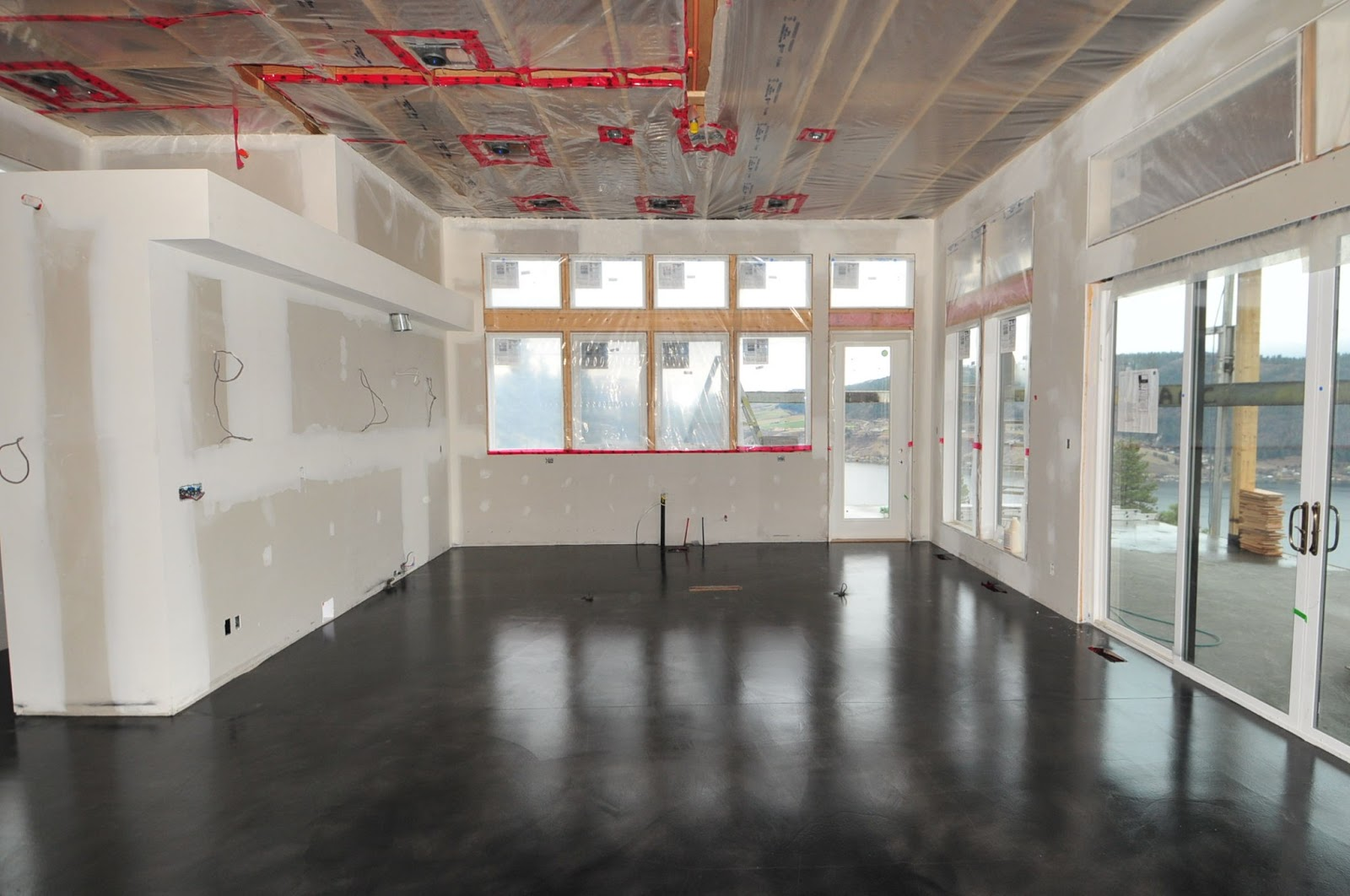 MODE CONCRETE Black Acid Stained Modern Concrete Floor created in
