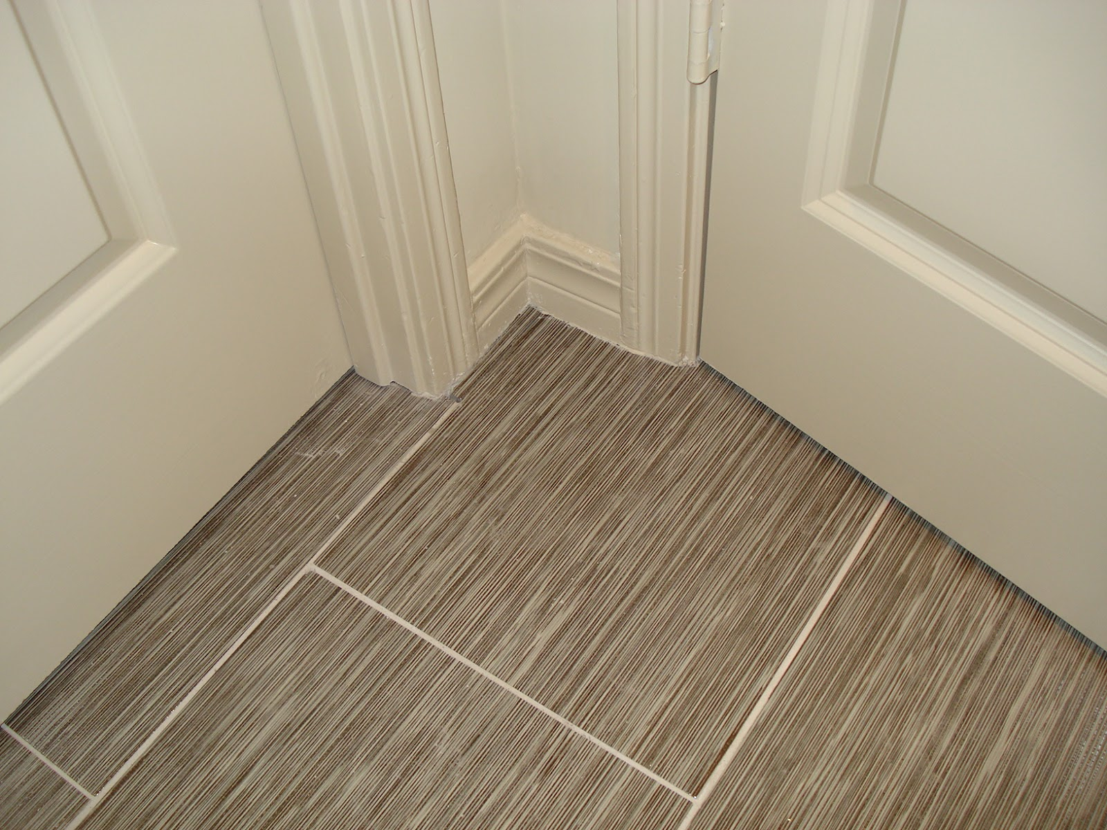 Replacing broken porcelain floor tile confessions of a tile setter this repair looked as if nothing had ever happened just like this repair below nope you cant see it can you and that is the way a repair should be dailygadgetfo Images