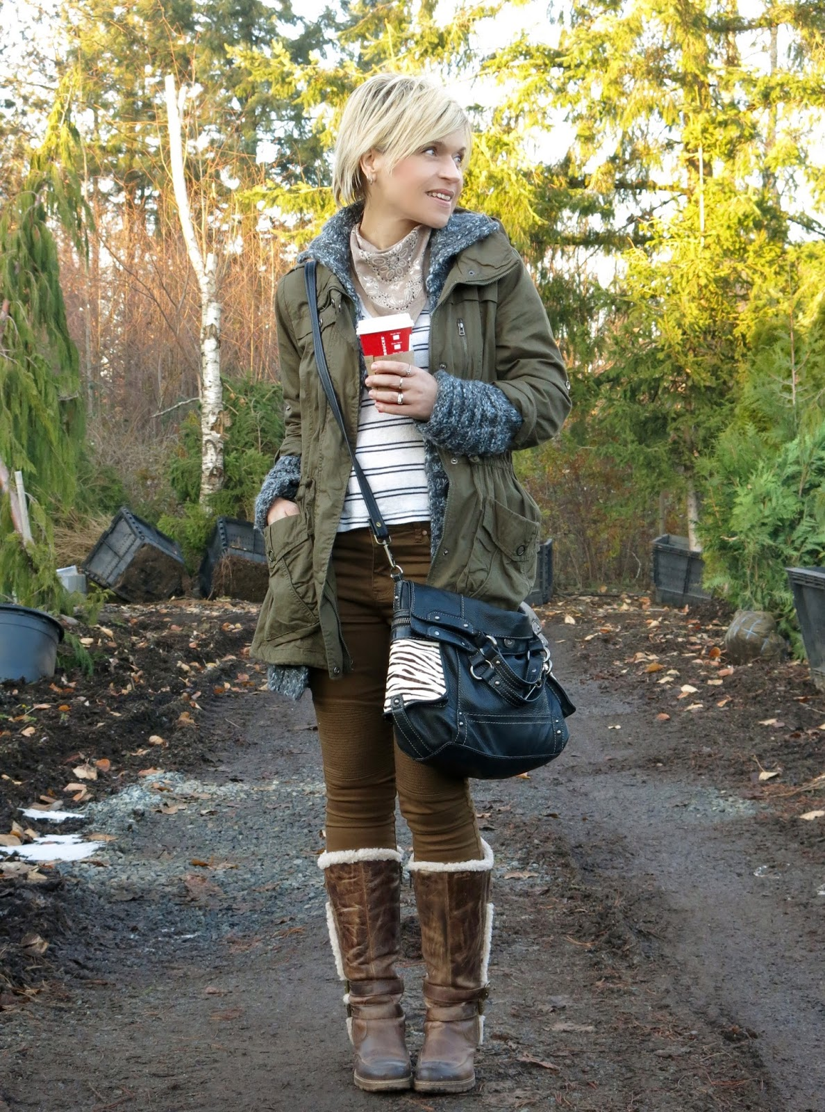 styling khaki skinnies with lug-soled boots, layered jackets, and a neckerchief