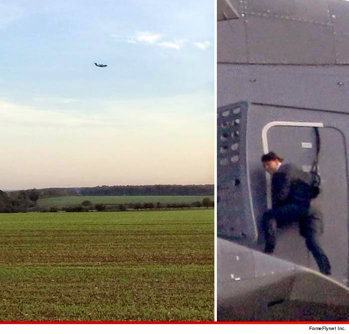 OMG! Tom Cruise flies high with the plane.. outside