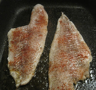 raw fish fillets with cayenne pepper