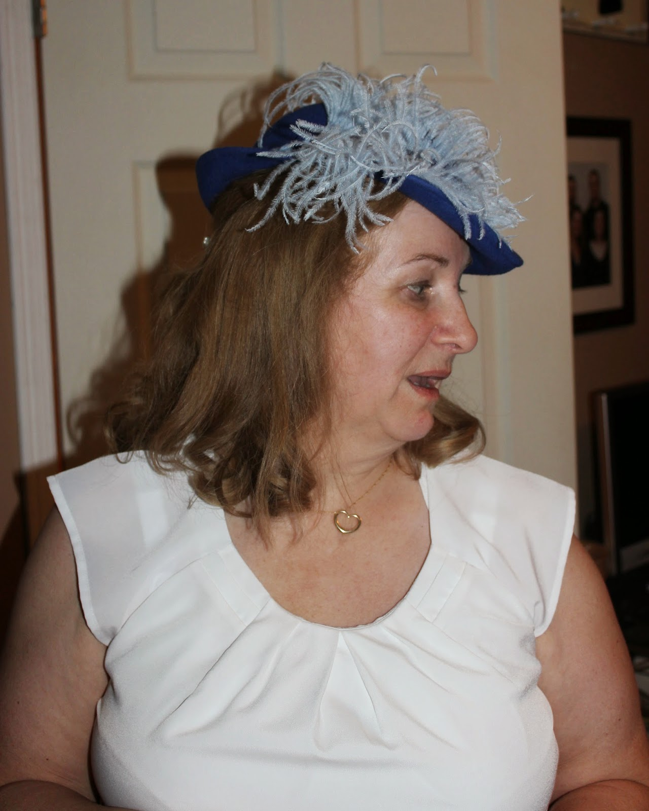 blue hat, feather in hat, middle aged woman in hat