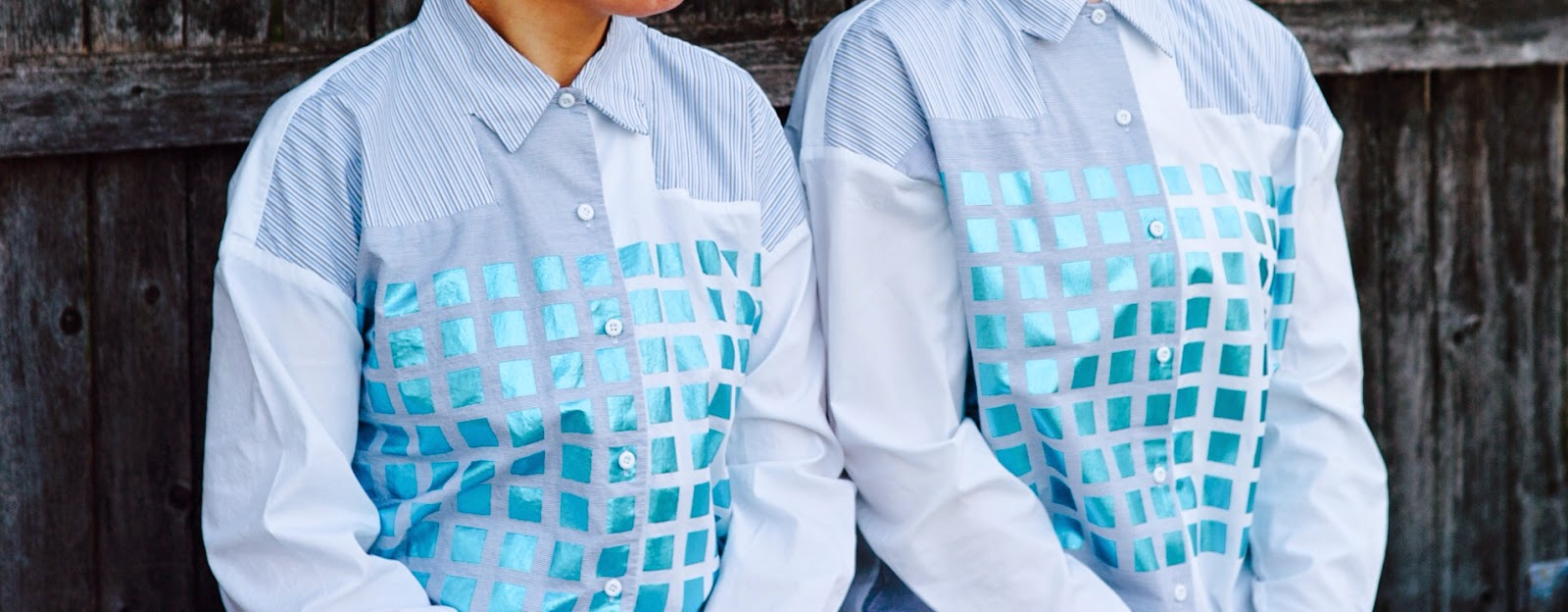 a white button down shirt with blue metallic squares detail