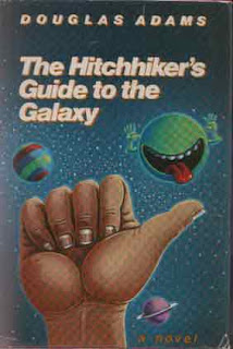 A planet with a tongue sticking out, and a hitchhiking thumb on the cover