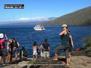 Travel Boldly Galapagos Island -  A group of hikers wait for a panga to ferry them back to the Guantanamera yacht.