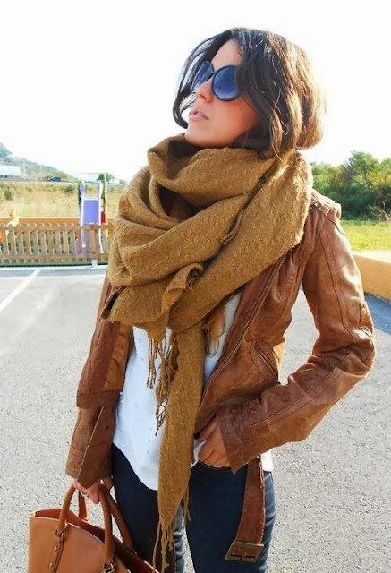 Brown Leather Jacket With Camel Color Scarf And Dark Blue Jeans