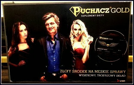 Obraz: billboard z Jakimowiczem reklamujący suplement Puchacz Gold