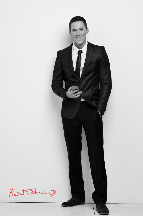 Full length in suit with smile; contemporary menswear catalogue look in black and white; studio modelling portfolio by Kent Johnson.