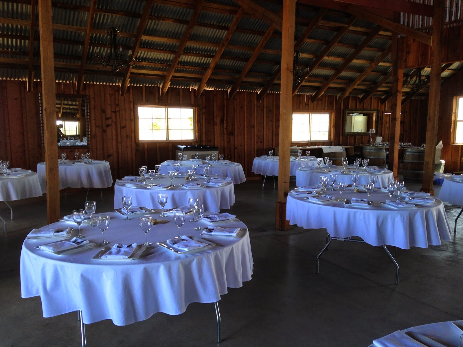 Table settings in a barn for a wedding in California