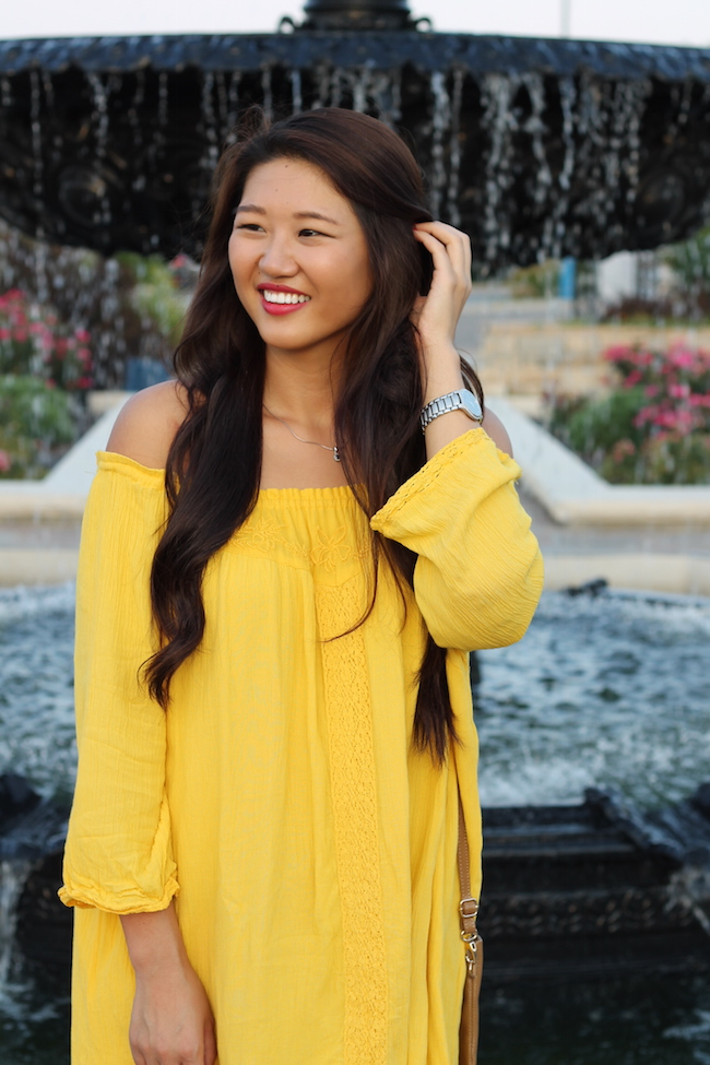 Yellow dress nail polish