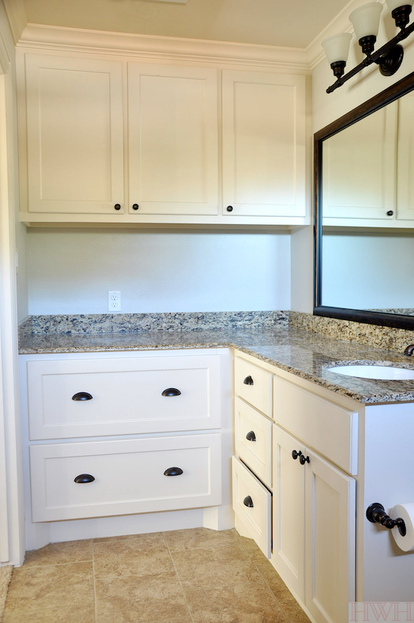 Bathroom with deep counters perfect for drying and changing a baby, with extra large drawers to function as dresser for clothes or other storage | Honey We're Home