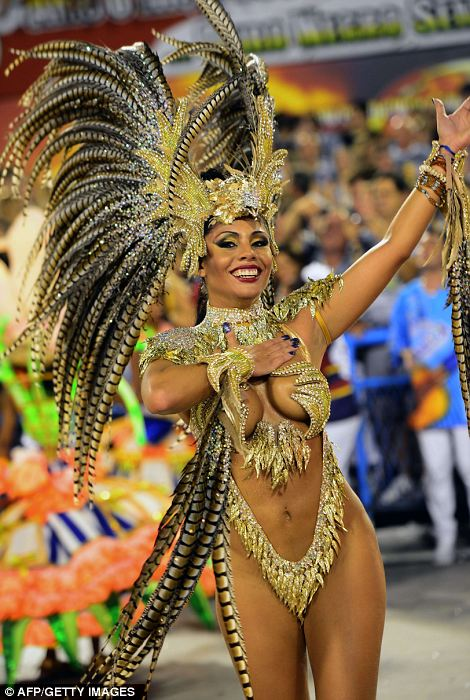 The greatest party on Earth': Rio Carnival reaches its breathtaking climax as thousands of scantily-clad samba dancers gyrate through the streets in an explosion of music and colour.