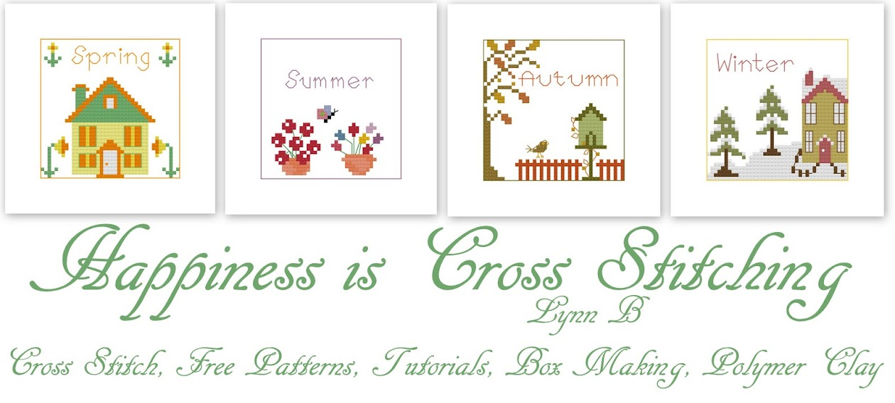 Happiness is Cross Stitching