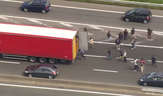 Calais migrants breaking into lorries