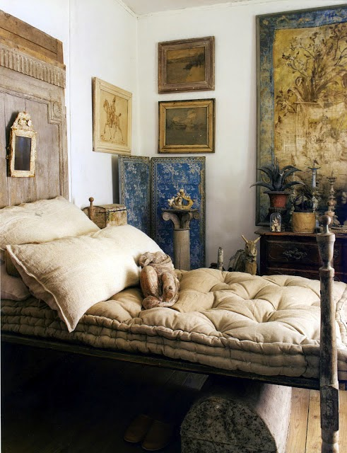 A simple element like a French mattress-style cushion takes this bedroom to a different world. old world bedroom