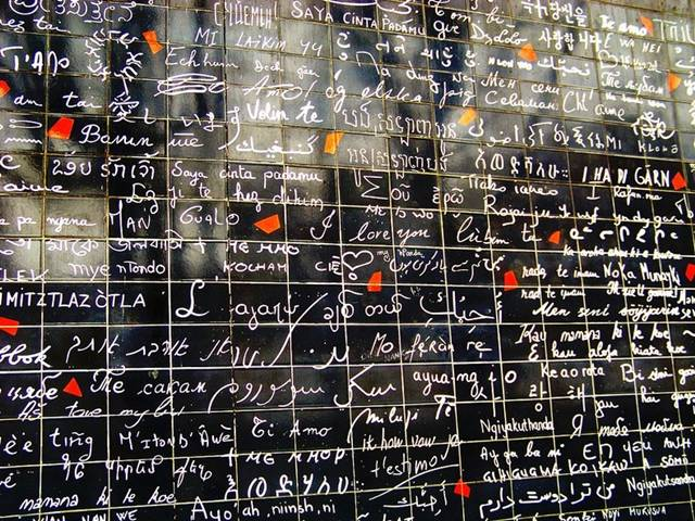 "The ""I love you"" wall stands at the center of the Abbesses garden at Montmartre, Paris, and covers a surface area of 40 square meters with a total of 612 tiles of enameled lava. The phrase ""I love you"" is written more than a thousand times in over 300 different languages."