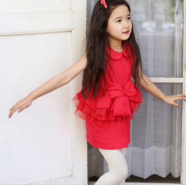 gambar cantik anak kecil memakai gaun pesta pink