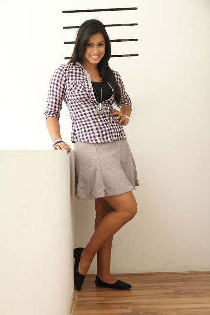Thulasi Nair in mini skirt